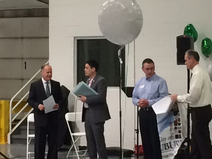 Mayor Kevin McDaniel, along with City Manager Tom Tanghe, and Assistant City Manager Don Grice, presented a City Flag to Shannon Fasteners to show the City's commitment and partnership in their new endeavor.