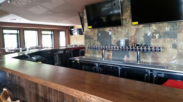 The new 60 foot wraparound bar has 24 taps, including an assortment of Michigan craft beers