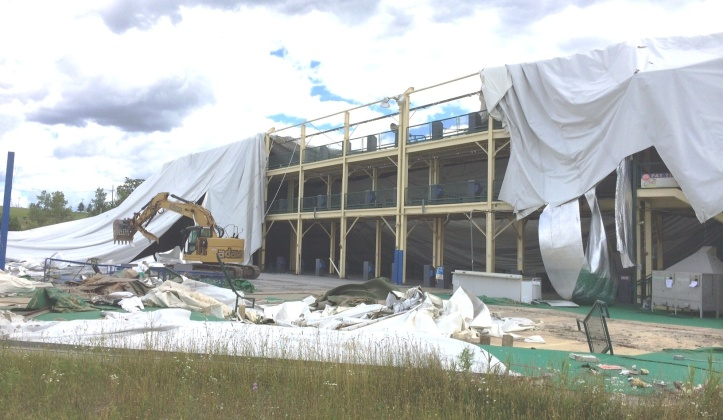 Workers removing the dome fabric today.  The structure in the background is the old driving range platform.