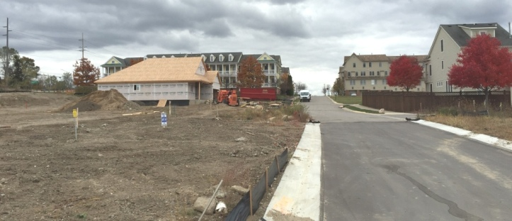 View of home and street looking south toward Forester Square Condominiums