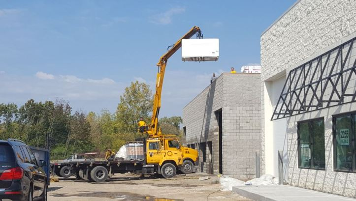 Insulation delivery to third building under construction