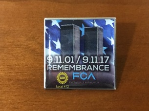 A commemorative pin was given to each attendee at today's remembrance.
